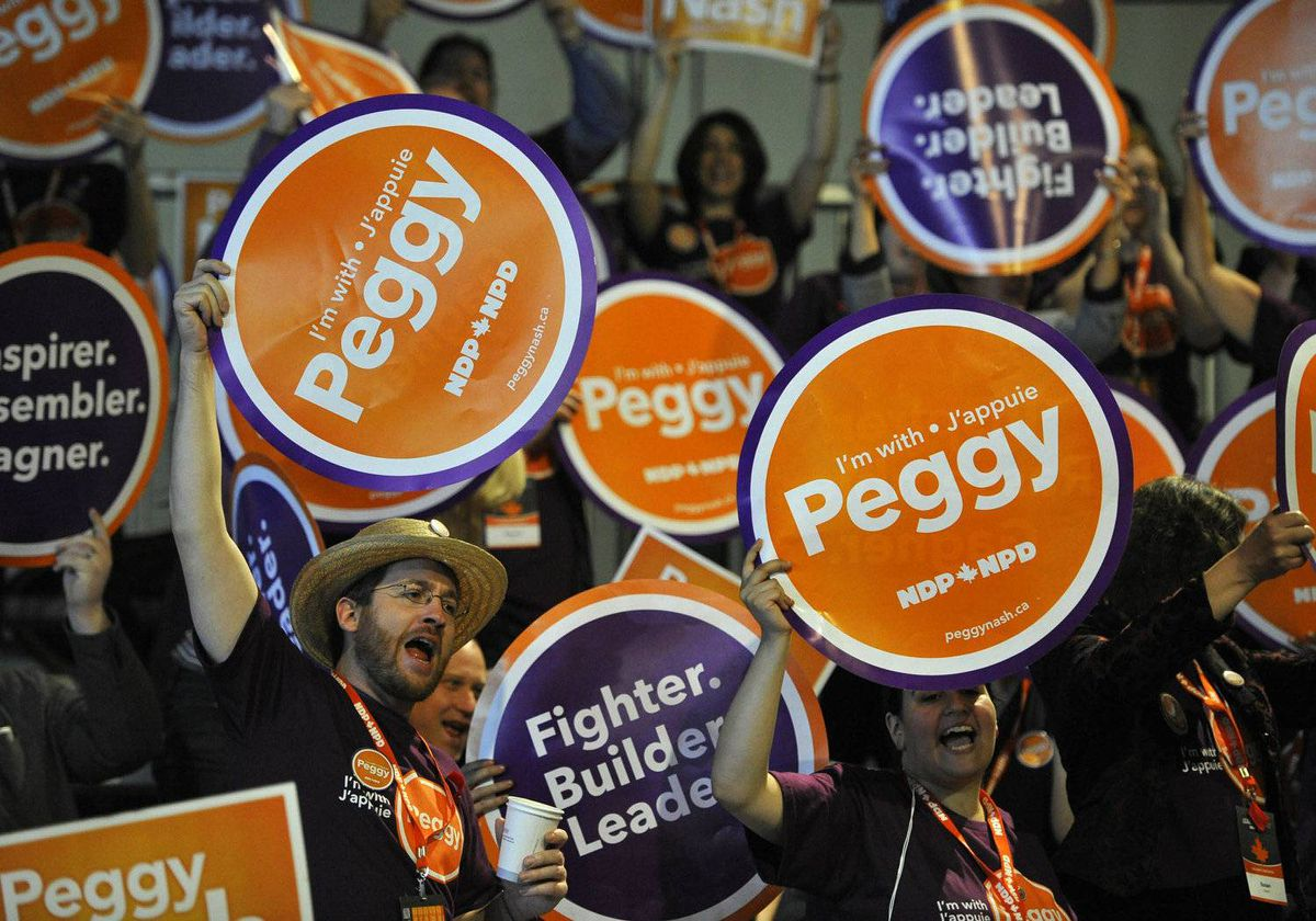 Supporters of candidate Peggy Nash cheer on their candidate at the NDP leadership convention at the Metro Toronto Convention Centre in Toronto, Ont. Friday, March 23, 2012.