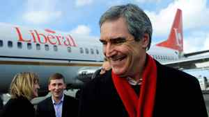 Liberal Leader Michael Ignatieff smiles as he arrives at the airport in St. John's on April 4, 2011.