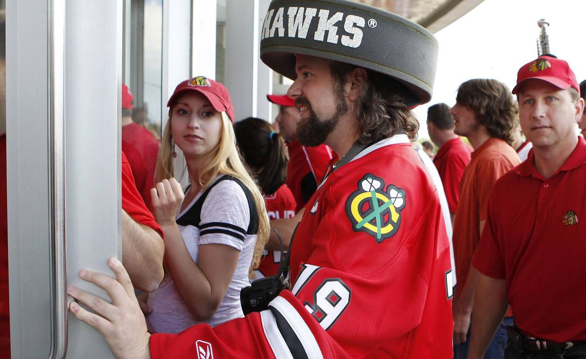 Chicago Blackhawks fans enter the United Center for Game 5 against the Philadelphia Flyers in the NHL Stanley Cup hockey finals between the Philadelphia Flyers and the Blackhawks on Sunday, June 6, 2010, in Chicago. (AP Photo/Nam Y. Huh)