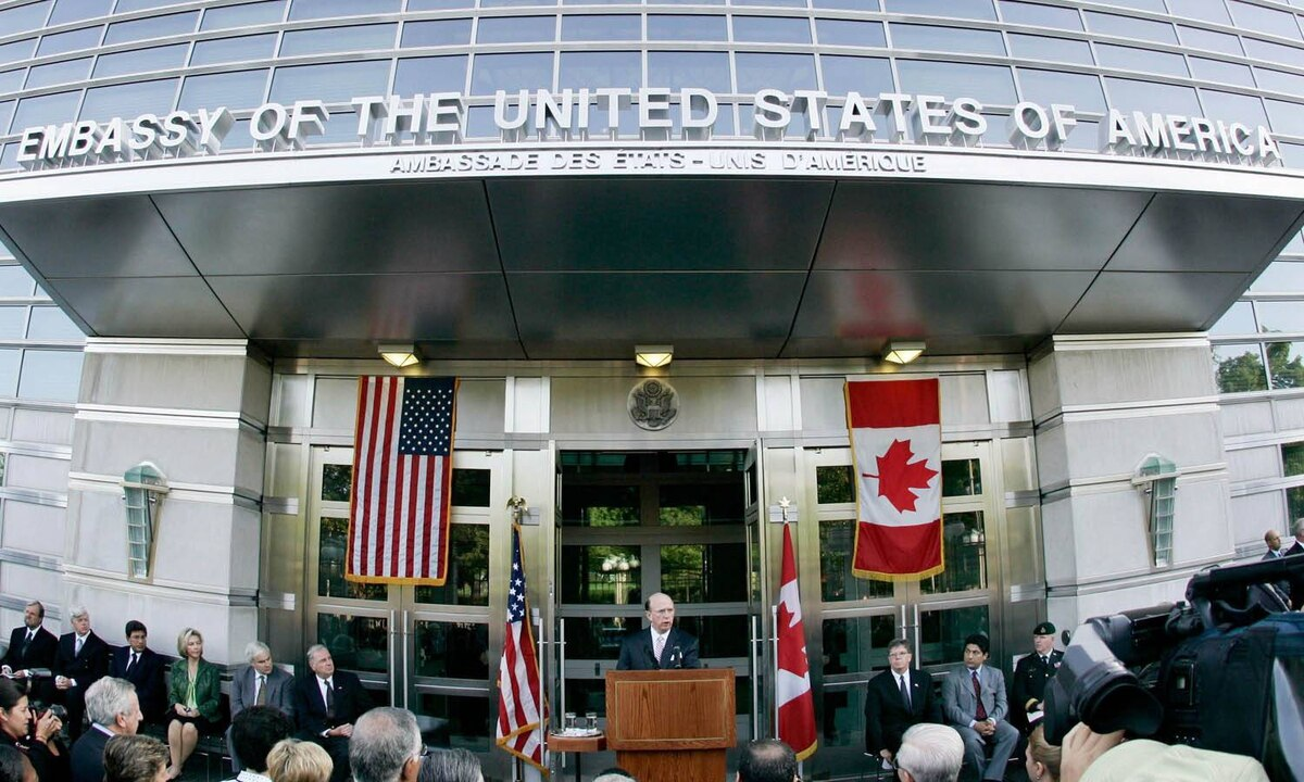 Then-U.S. ambassador David Wilkins addresses a crowd outside the U.S. embassy in Ottawa in this 2005 file photo.