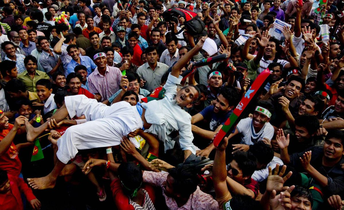 Fans celebrate ahead of the start of the CWC Cricket World Cup Opening ceremony on February 17, 2011 in Dhaka, Bangladesh.
