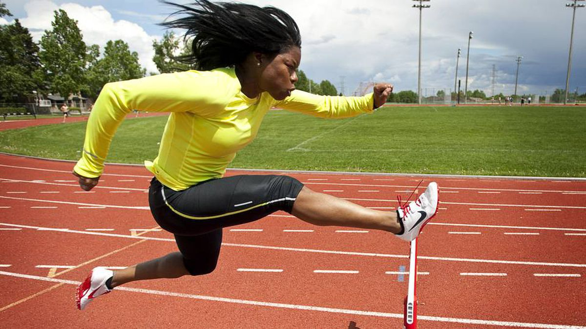 Hurdler Perdita Felicien, who now lives in Calgary, Alta., trains at the Glenmore Atheltic Park Monday, June 20, 2011.