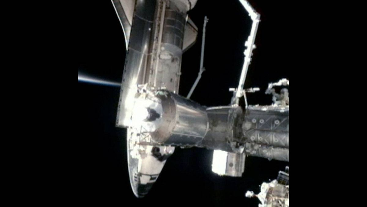 In this video screen grab provided by the National Aeronautics and Space Administration (NASA), NASA space shuttle Atlantis docks for the last time with the International Space Station July 10, 2011 in space.