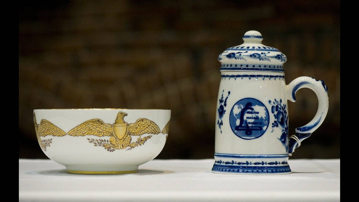 Gifts include a bowl from former U.S. President Bill Clinton, left, and a beer stein from former Russian president Boris Yeltsin.