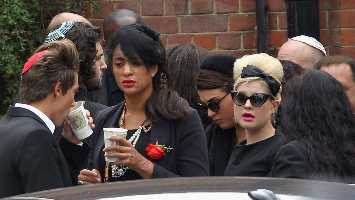 Kelly Osbourne (right) arrives for the cremation of Amy Winehouse at Golders Green Crematorium on July 26, 2011 in London, England.