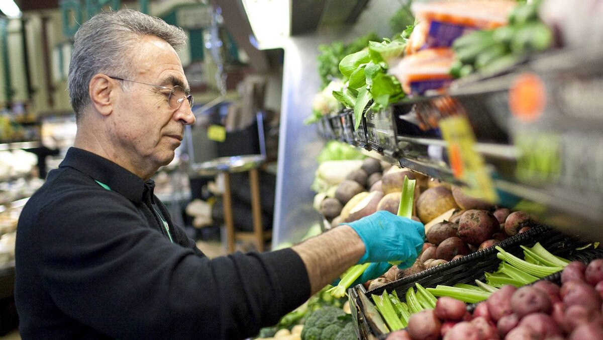 A grocer tends to produce at a Vancouver store on May 12, 2010.