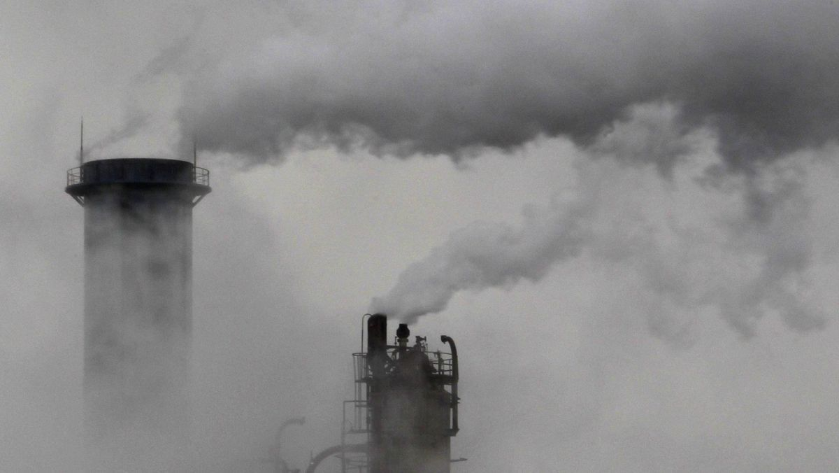 Smoke billows from chimneys at an industrial district near Tokyo February 28, 2011.