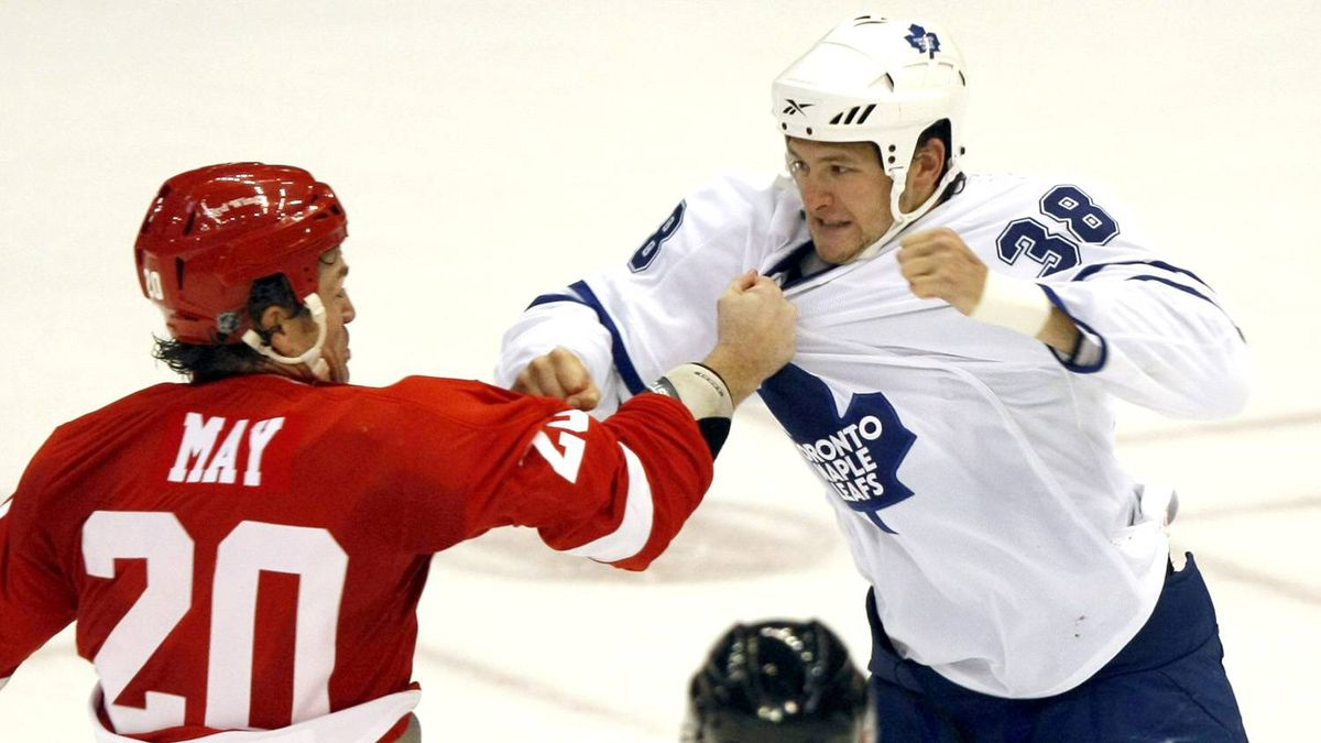 Toronto Maple Leafs Jay Rosehill, right, and Detroit Red Wings Brad May fight during the second period of their NHL preseason hockey game in Detroit, Michigan, September 25, 2009.