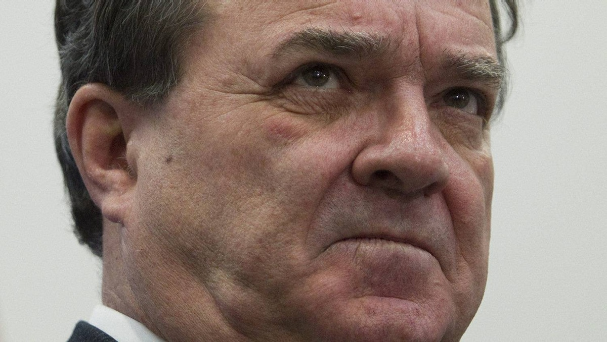 Finance Minister Jim Flaherty listens to a reporter's question in Toronto on Feb. 23, 2012.
