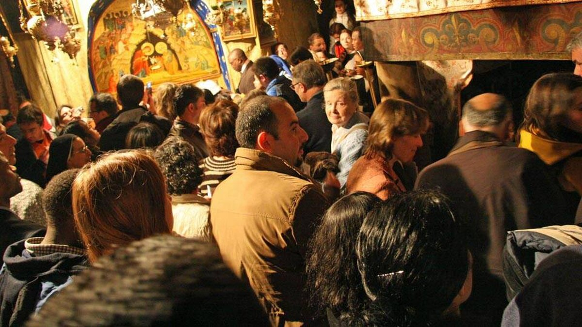 Pilgrims gather in Bethlehem's Grotto of the Nativity, where tradition holds Jesus was born, as midnight approaches on Christmas Eve. The small, cave-like space would fit in many Canadians' living room.