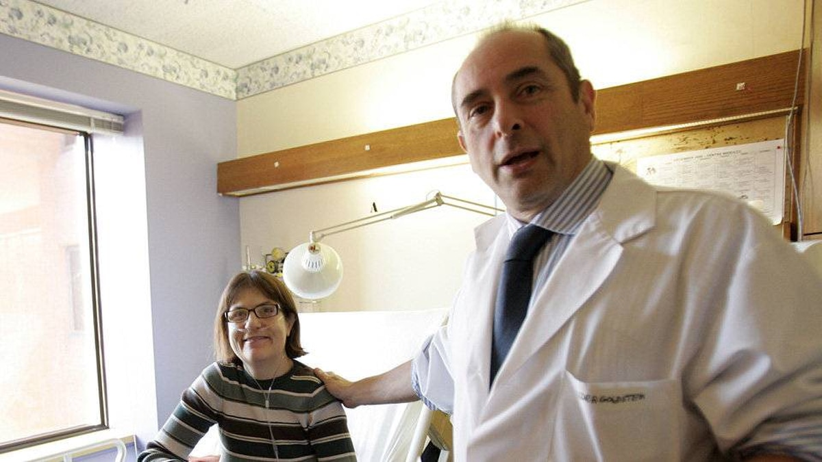 Dr. Roger Goldstein, right, speaks with his patient Christina Hamann, the first person in North America to undergo a procedure to implant a pacemaker in her diaphragm to help her breathe, in hospital in Toronto December 22, 2009.