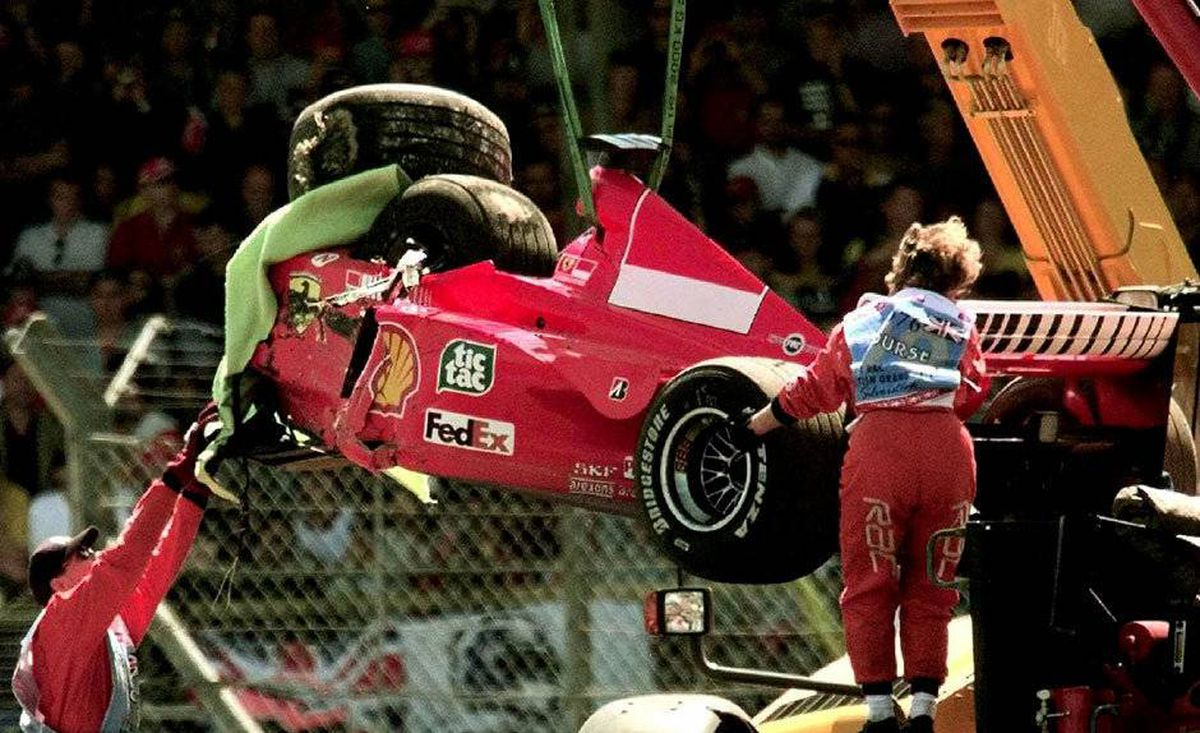 Michael Schumacher broke his leg in a crash at the 1999 British Grand Prix and missed six races. He returned for the final two races of the year and took second in both. The next season, he began a run of five consecutive world championships. Pictured, his damaged Ferrari is lifted onto a flat bed truck after the crash on the first lap at Stowe corner, during the British Grand Prix in Silverstone, England.
