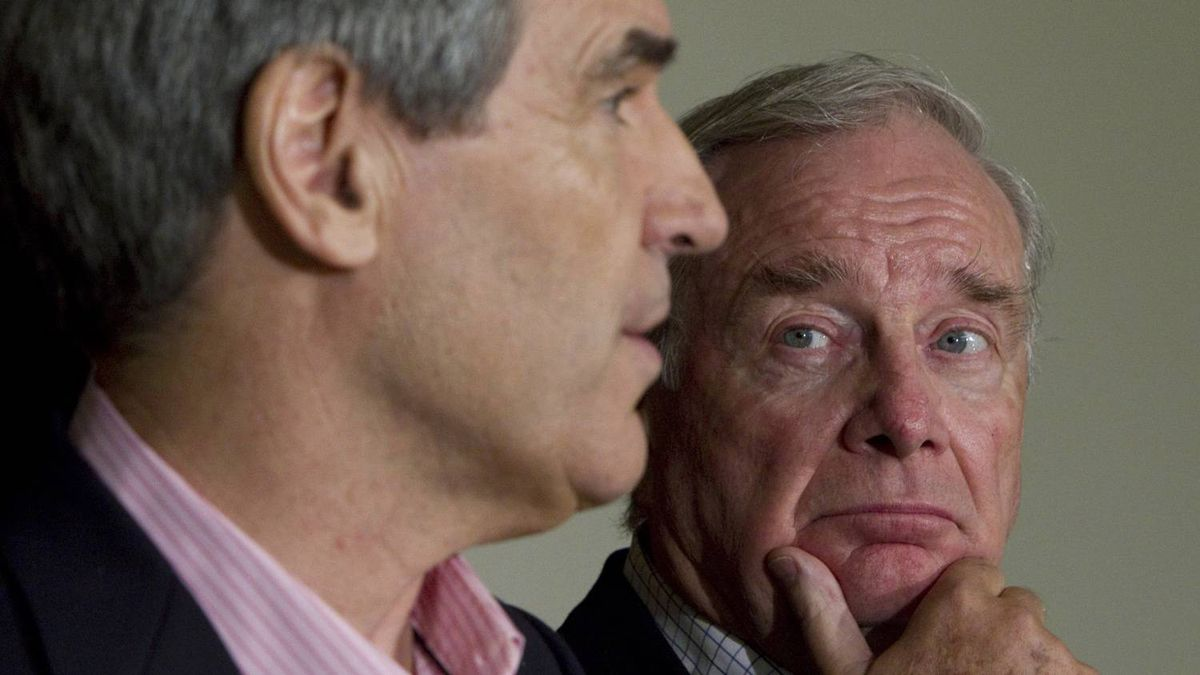 Liberal leader Michael Ignatieff, left, and former Prime Minister Paul Martin address the media in Edmonton on Saturday, April 16, 2011.