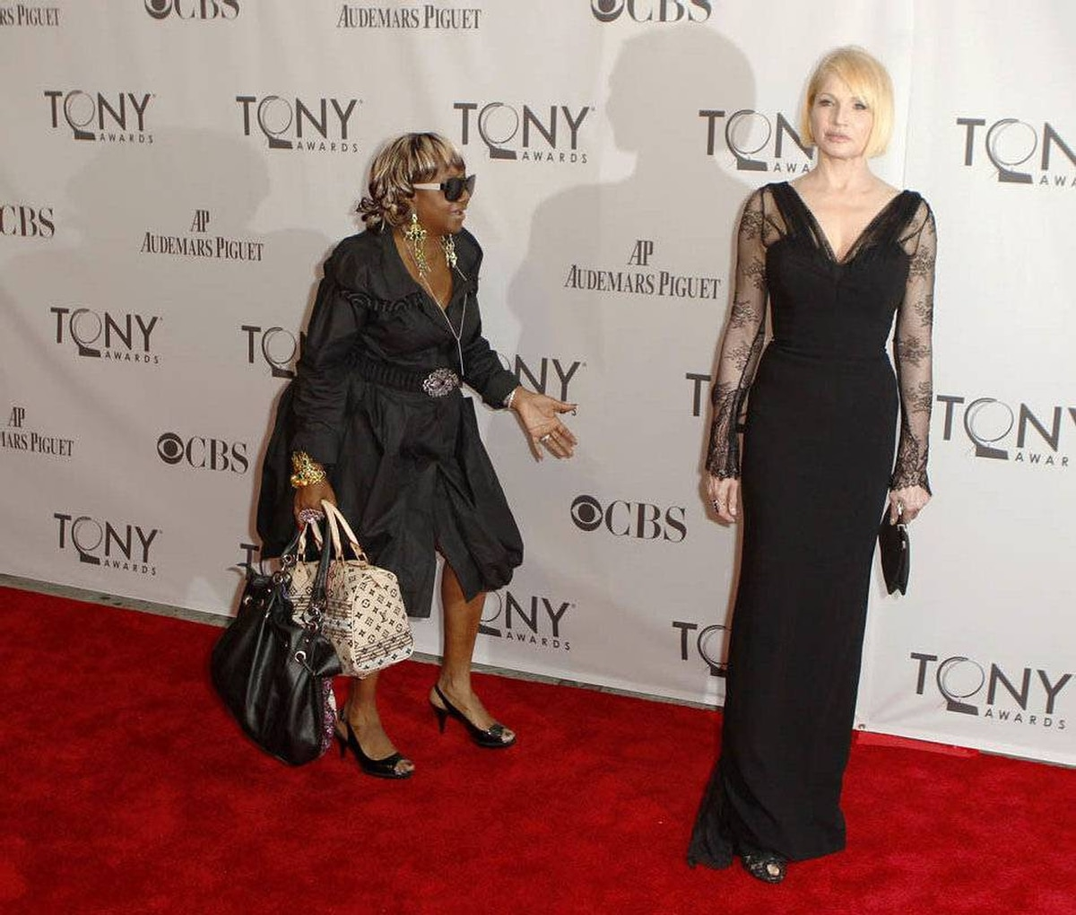 Ellen Barkin, nominated for best performance by an actress in a featured role in a play for The Normal Heart, is followed onto the red carpet by an unidentified woman as she arrives for the American Theatre Wing's 65th annual Tony Awards ceremony in New York, June 12, 2011.