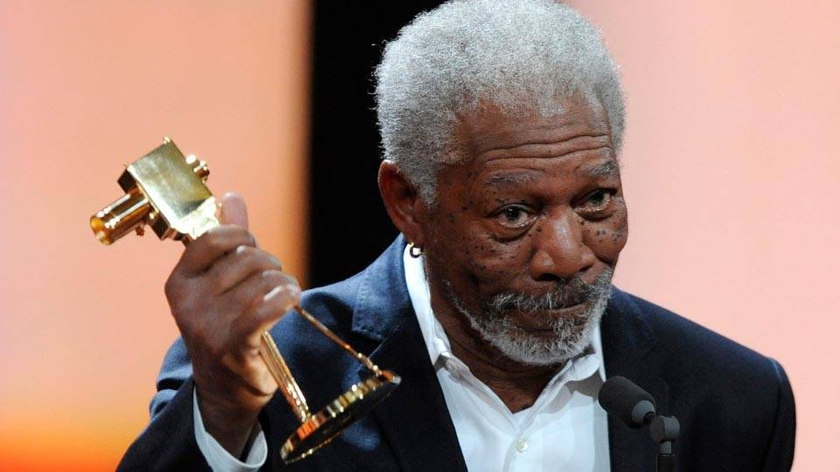 """US actor Morgan Freeman holds his trophy in the category """"International Lifetime Achievement"""" during the 47th Golden Camera award ceremony in Berlin, Feb. 4, 2012."""