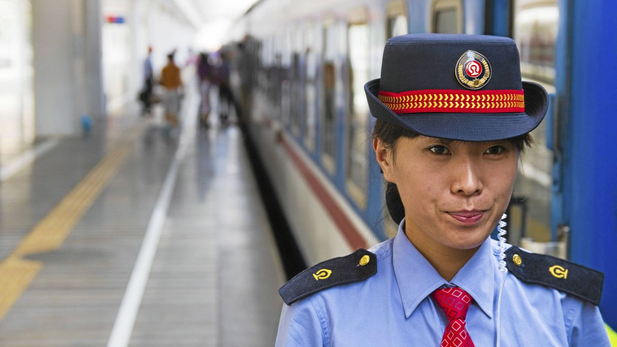 An attendant waits for the Shenzhen to Shanghai train to depart.