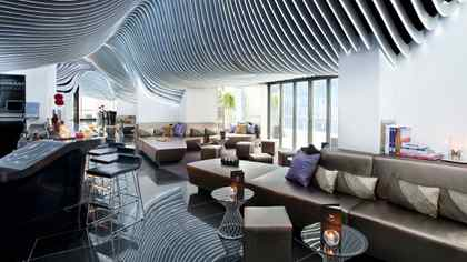 The Living Room Bar at W New York Downtown takes up most of the lobby, making it clear the space is intended more for lounging than as a thoroughfare.