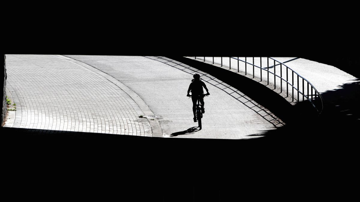 A cyclist is silhouetted while passing underneath West Georgia St. near Stanley Park in Vancouver, B.C., on Monday September 13, 2010. DARRYL DYCK FOR THE GLOBE AND MAIL