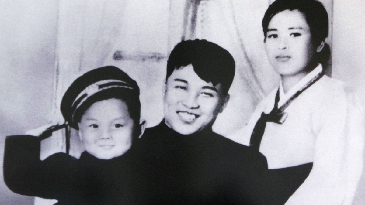 A picture of North Korean founder Kim Il-sung (C), his first wife Kim Jong-suk (R) and his son Kim Jong-il, is displayed at the Unification Hall at the West Seoul Life Science High School.