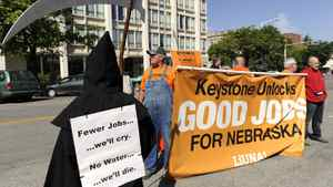 Supporters and opponents of the Keystone XL pipeline demonstrate in Lincoln, Neb.
