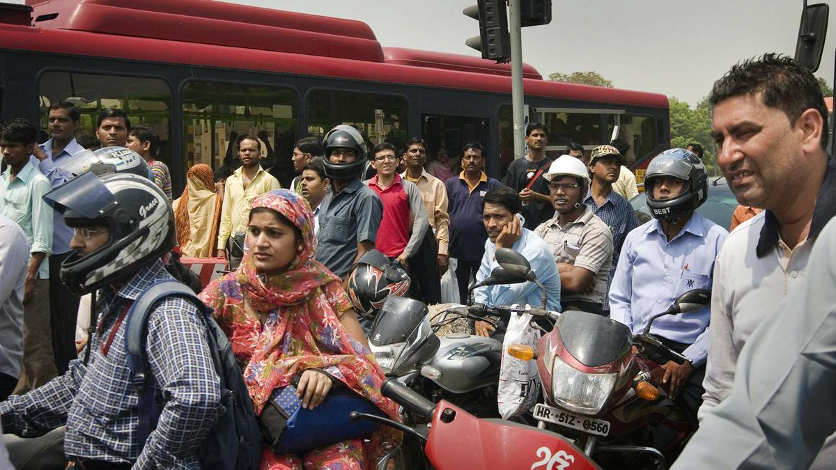 Rush hour commuters wait in New Delhi, India, Monday, May 16, 2011.