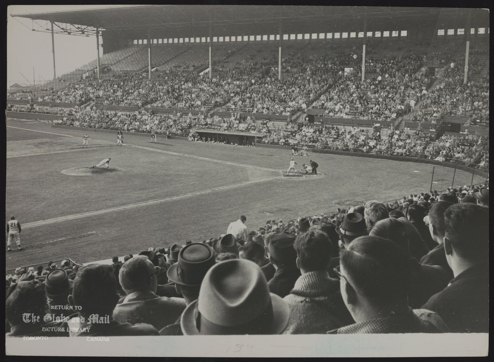TORONTO MAPLE LEAF BASEBALE CLUB Back Row View of Action at Maple Leaf Stadium Yesterday as 1961 Leafs Belted Out 15-3 Opening Day Win Over Jersey City Steve Ridzik pitches to Octavio Rojas in first inning. Crowd of 10,272 saw Lests in homer-hitting mood.