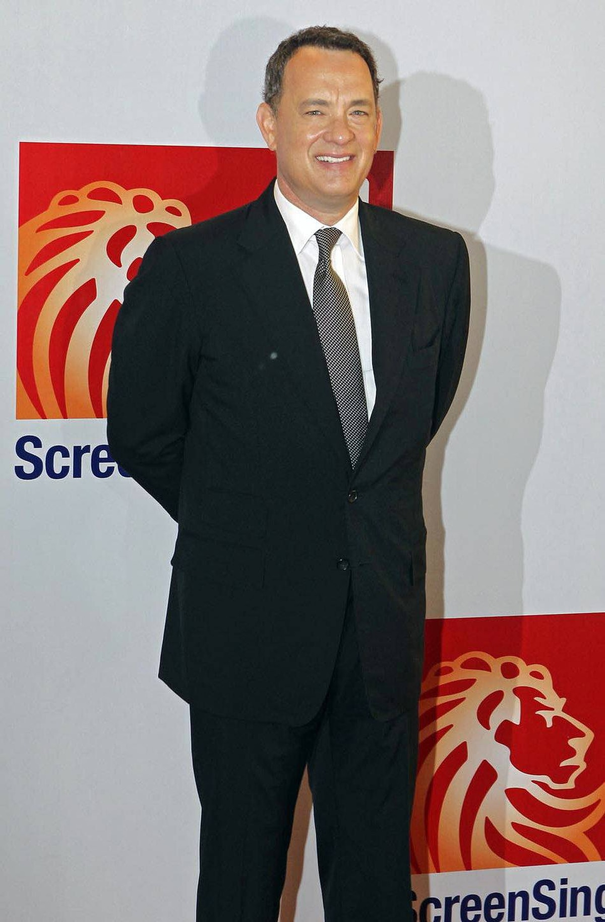 Tom Hanks arrives for the premiere of Larry Crowne, Saturday June 11, 2011, in Singapore.