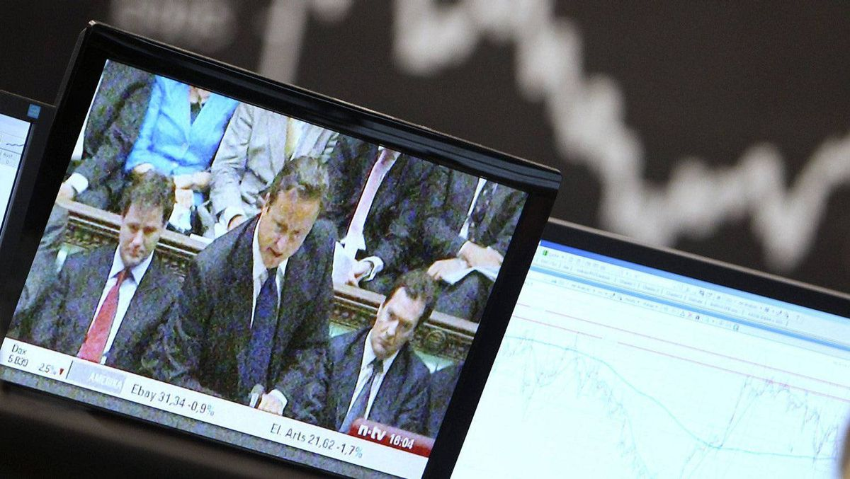 A news story about British Prime Minister David Cameron is broadcast on a TV screen at the stock market in Frankfurt, Germany, Monday, Dec. 12, 2011, when the German stock index DAX went down more than 2 per cent.
