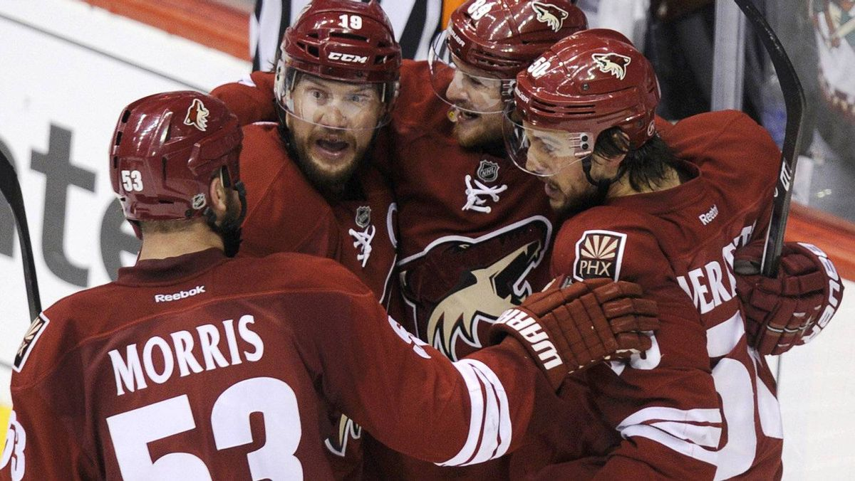 Phoenix Coyotes right wing Mikkel Boedker (89) celebrates his 2nd period goal against the Los Angeles Kings with teammates Shane Doan (19), Antoine Vermette (50) and Derek Morris (53) during Game 1 of the NHL Western Conference hockey finals in Glendale, Arizona, May 13, 2012. REUTERS/Todd Korol