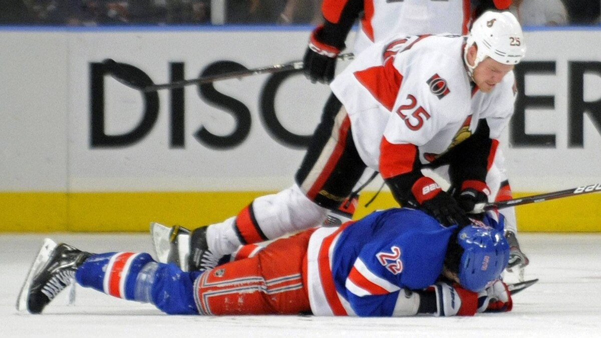 Ottawa Senators' Chris Neil (25) checks New York Rangers' Brian Boyle during the third period of Game 5 of an NHL Stanley Cup first-round hockey playoff series, Saturday, April 21, 2012, at New York's Madison Square Garden. The Senators won 2-0 to lead the series 3-2.
