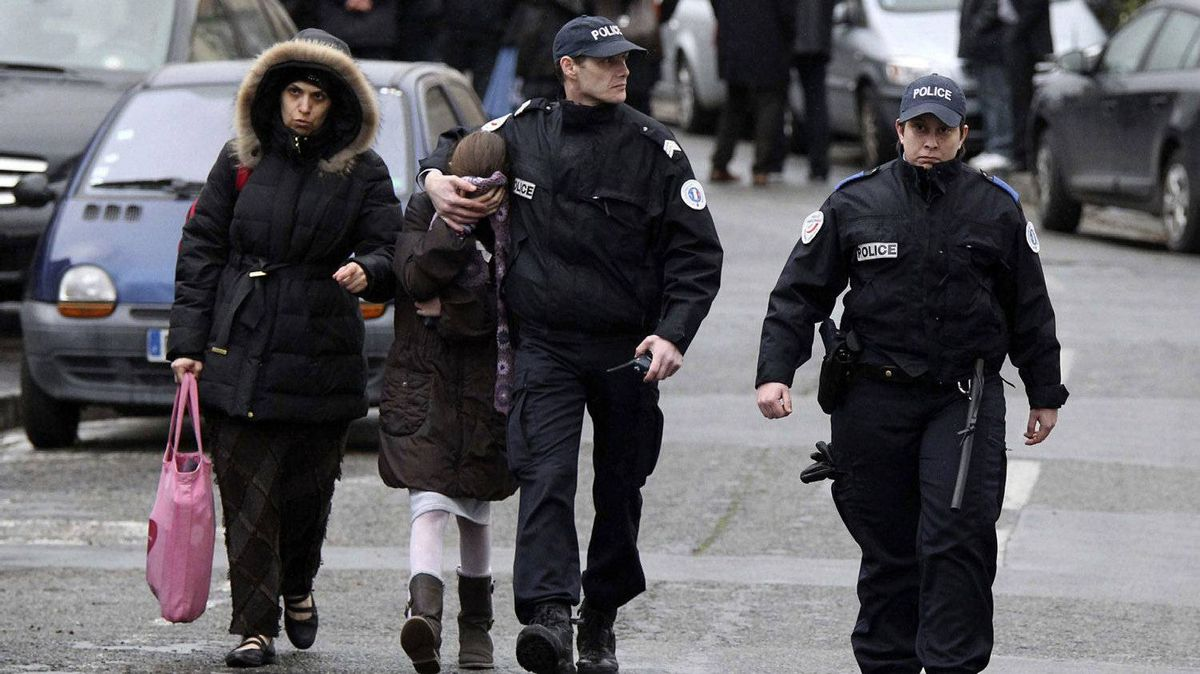 A father and his two sons were among four people who died Monday when a gunman opened fire in front of a Jewish school in a city in southwest France, the Toulouse prosecutor said Monday. (AP Photo/Manu Blondeau)