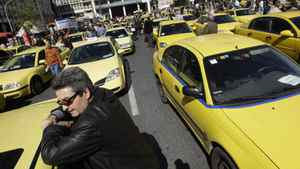 Taxi drivers demonstrate outside the Greek Finance Ministry during their 48-hours strike in Athens on Tuesday.