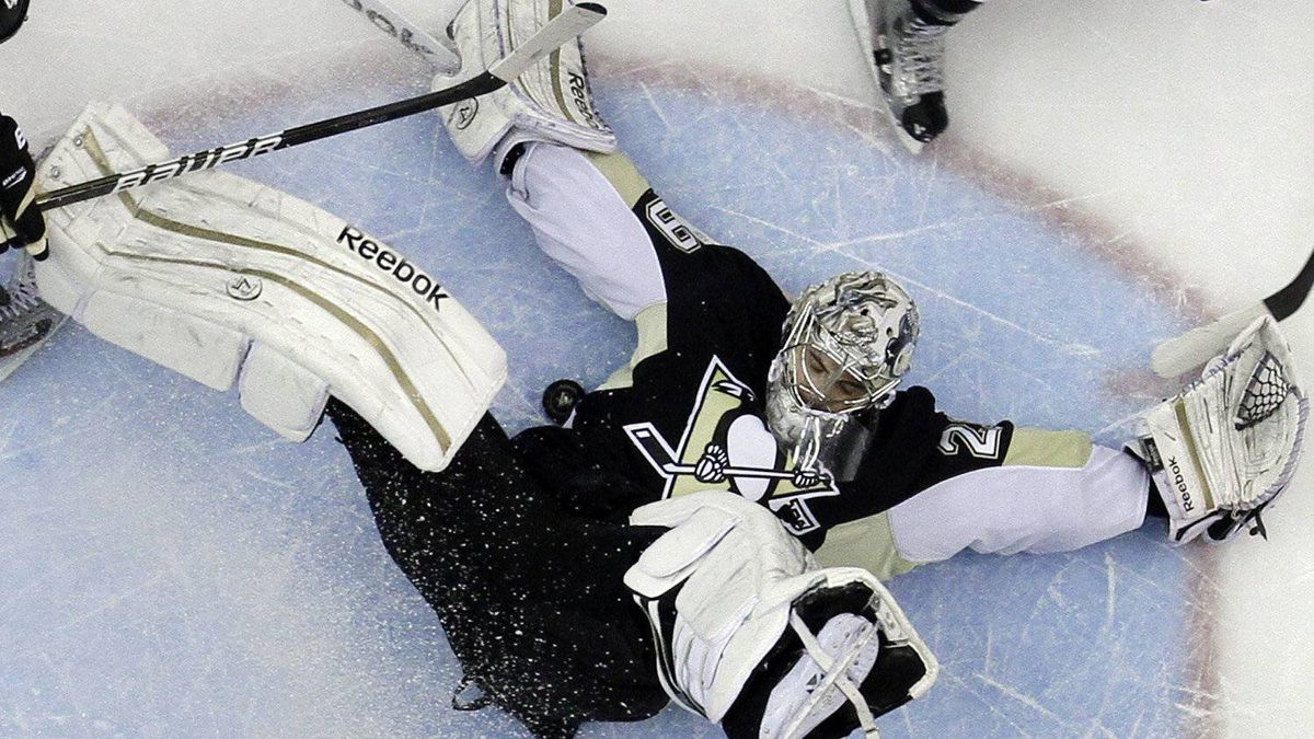Pittsburgh Penguins goalie Marc-Andre Fleury (29) blocks a shot by Tampa Bay Lightning's Nate Thompson (44) in the first period of an NHL hockey game in Pittsburgh Saturday, Feb. 25, 2012. The Penguins won 8-1. (AP Photo/Gene J. Puskar)