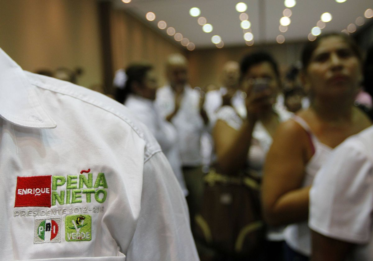 Supporters of Enrique Pena Nieto, the Institutional Revolutionary Party's presidential candidate, attend a campaign meeting in Ciudad del Carmen, Campeche, Mexico on May 16, 2012.