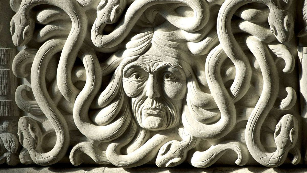A sculptured face is hit by morning light inside the House of Commons foyer entrance on March 24, 2011.