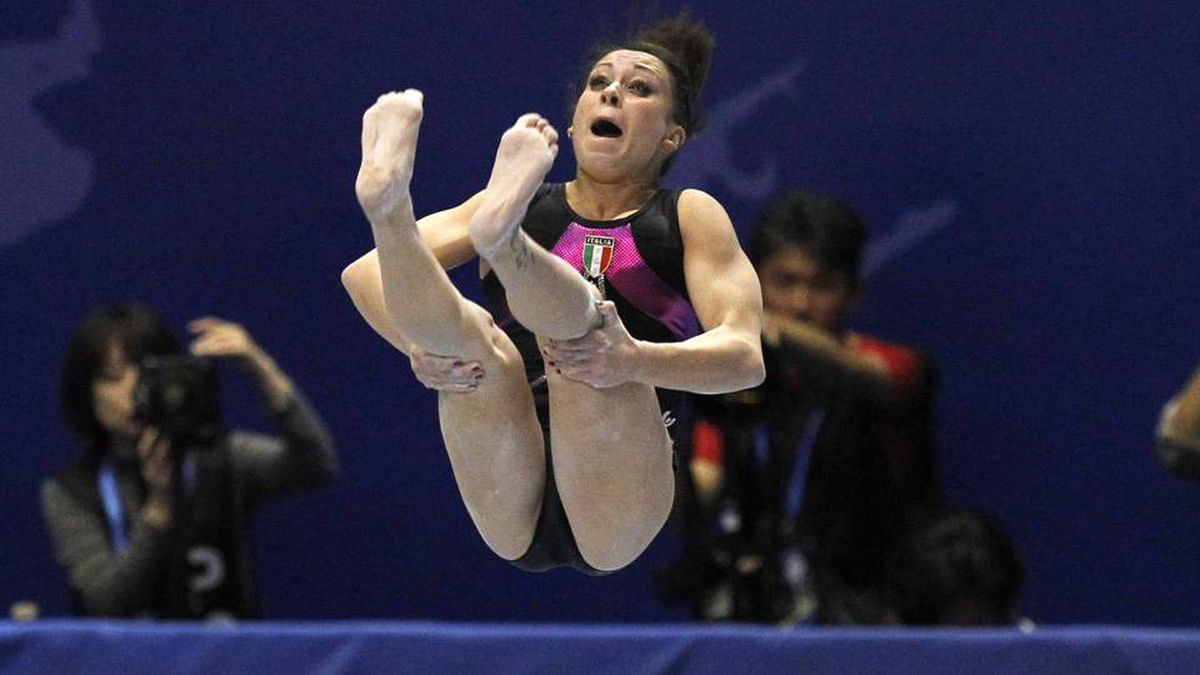 Italy's Vanessa Ferrari competes on the balance beam during the women's individual all-around final at the Artistic Gymnastics World Championships in Tokyo.
