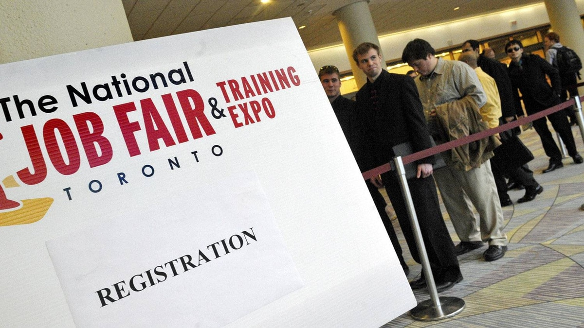 Dozens lin up to register for the The National Job Fair & Training Expo at the Metro Toronto Convention Centre, 2012.