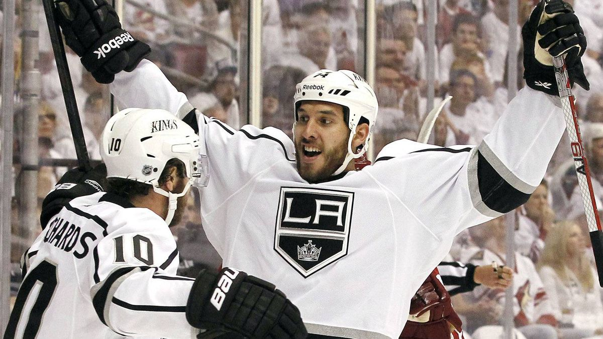 Los Angeles Kings' Dwight King (74) celebrates his goal against the Phoenix Coyotes with teammate Mike Richards (10) during the second period of Game 1 of the NHL hockey Stanley Cup Western Conference finals, Sunday, May 13, 2012, in Glendale, Ariz.(AP Photo/Ross D. Franklin)