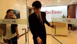 Employees are seen at the Rio Tinto office in Shanghai.