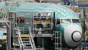 A technician works on the assembly of a Boeing 737 at the company's plant in Renton, Wash.
