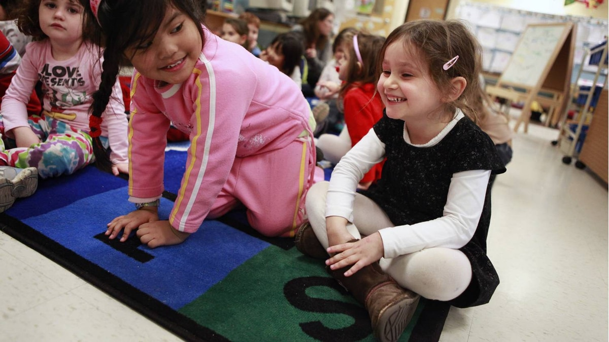 Millie Bolton participates in a group sing-a-long during full day Senior Kindergarten class at Westminster Public School. (Photo by Anne-Marie Jackson/ The Globe and Mail)