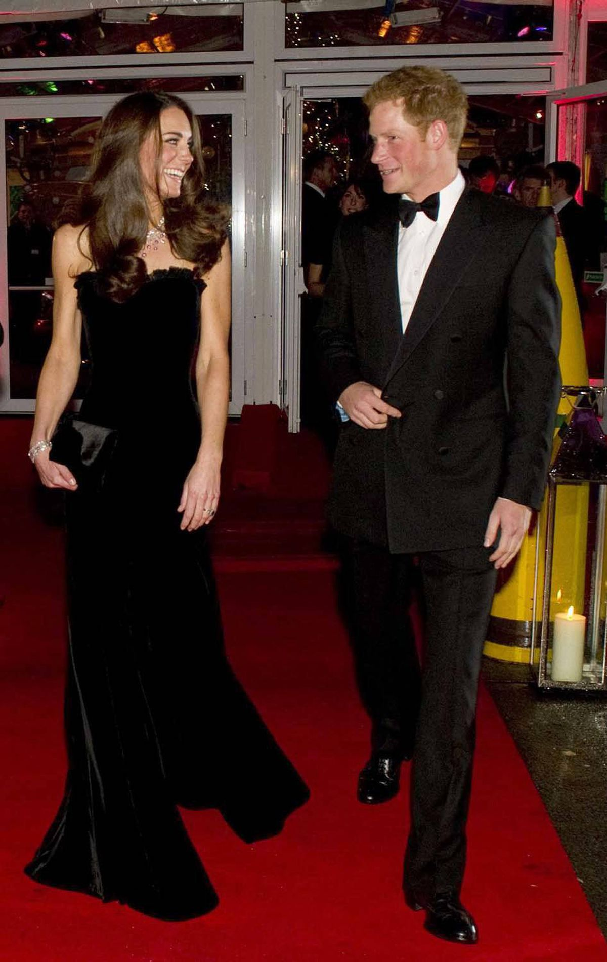 Kate shows off her slim figure in a luxe, velvet gown by Alexander McQueen at A Night of Heroes in London on December 19.