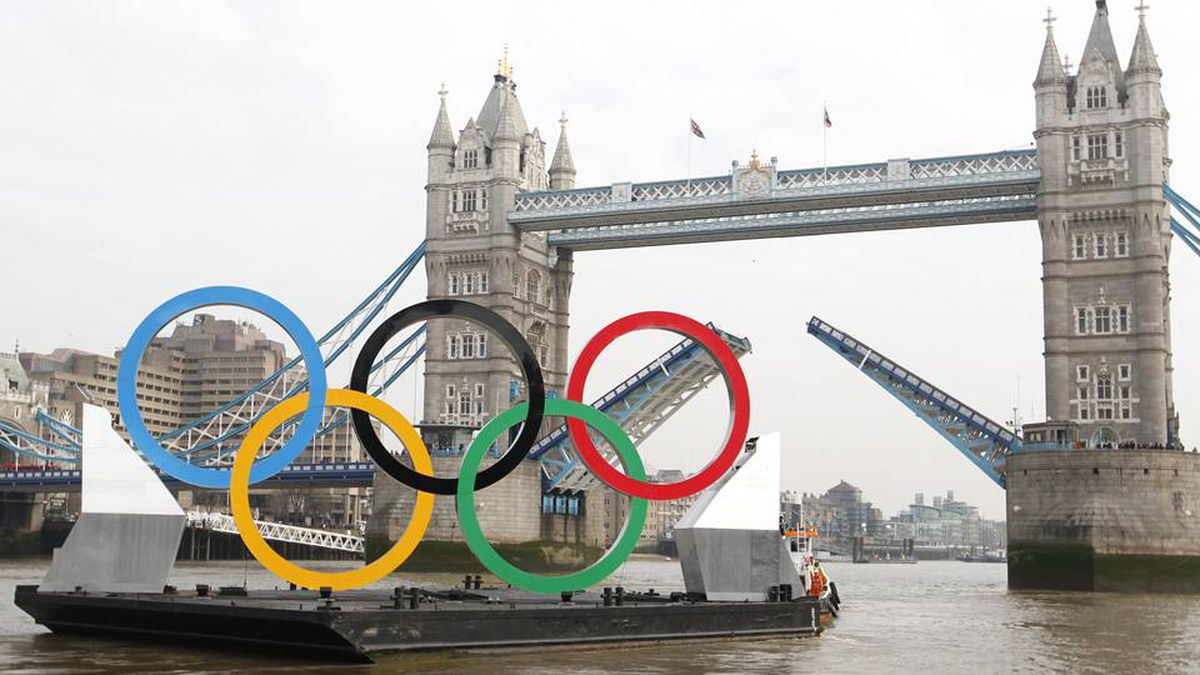 Olympic rings mounted on a barge are manoeuvred to pass under Tower Bridge during a promotional event on the River Thames in London February 28, 2012.