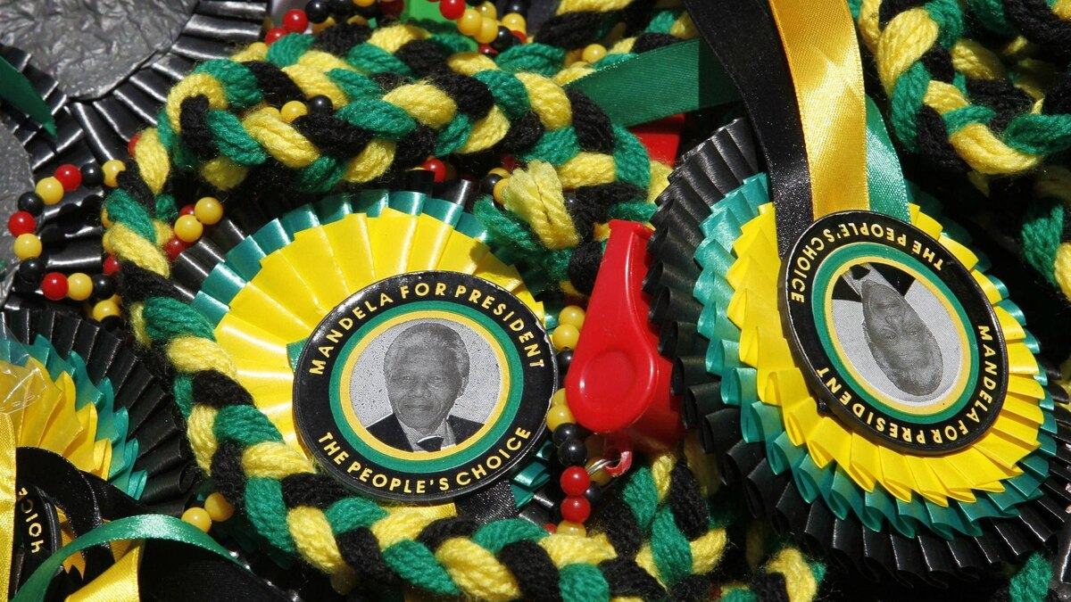 A picture of former South African President Nelson Mandela is seen on memorabilia sold in Bloemfontein Jan. 6, 2012.