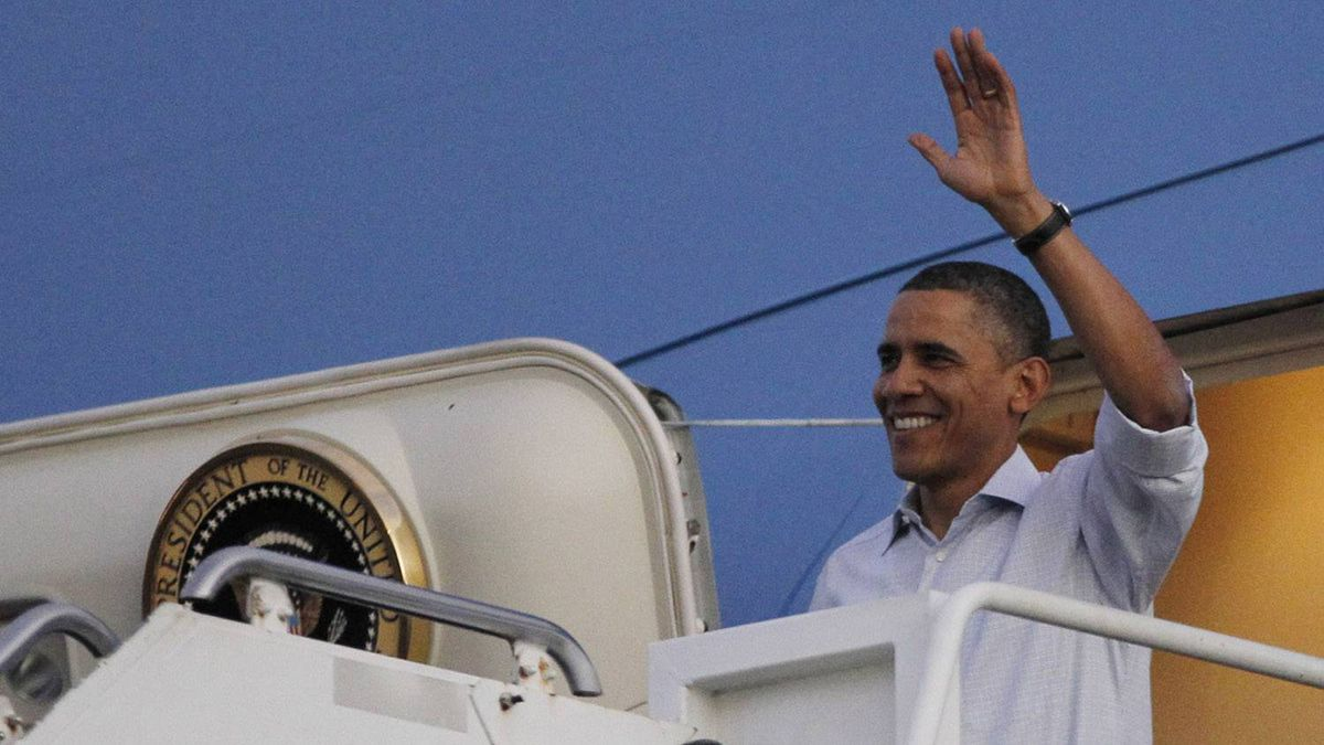U.S. President Barack Obama arrives at Hickam Air Base near Honolulu, Hawaii, December 23, 2011. Obama and his family are spending the end-of-year holidays in Hawaii.