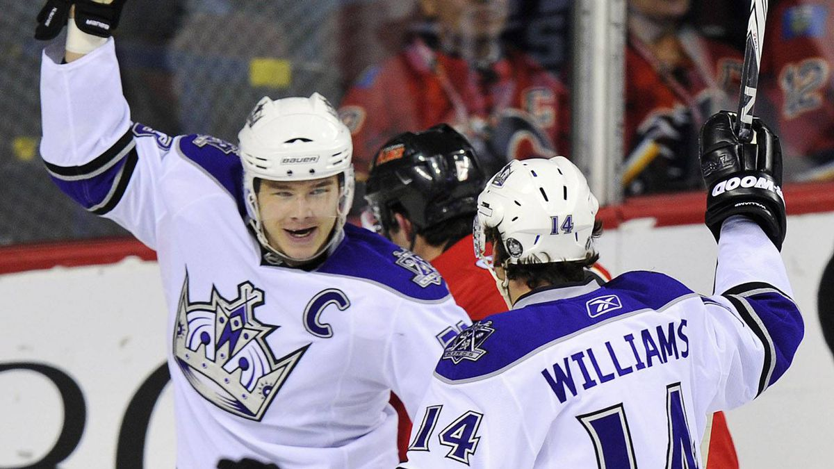 Los Angeles Kings' Dustin Brown (L) celebrates his goal with Justin Williams during the first period of their NHL hockey game against the Calgary Flames in Calgary, Alberta, February 5, 2011. The Kings won 4-3 in a shootout. REUTERS/Todd Korol