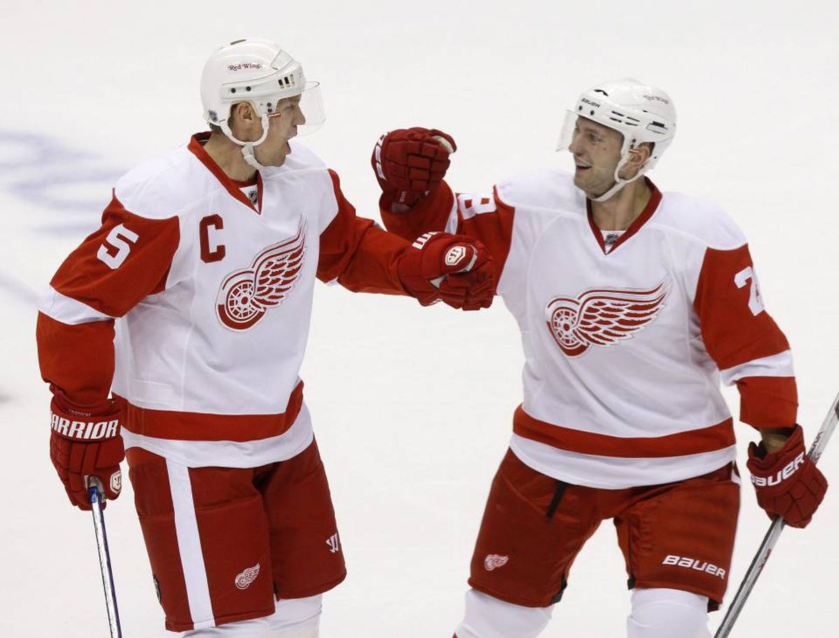 Detroit Red Wings Nicklas Lidstrom (5) celebrates his goal with teammate Brain Rafalski in the first period against the Phoenix Coyotes during Game 1 of their NHL Western Conference quarter-final hockey game in Glendale, Arizona April 14, 2010.