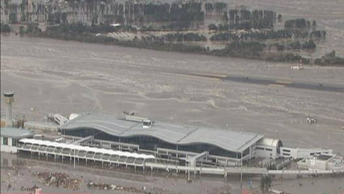 A tsunami engulfs the airport in Sendai, northeastern Japan, in this still image taken from video footage.