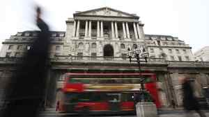 Pedestrians pass The Bank of England in the City of London February 14, 2012.