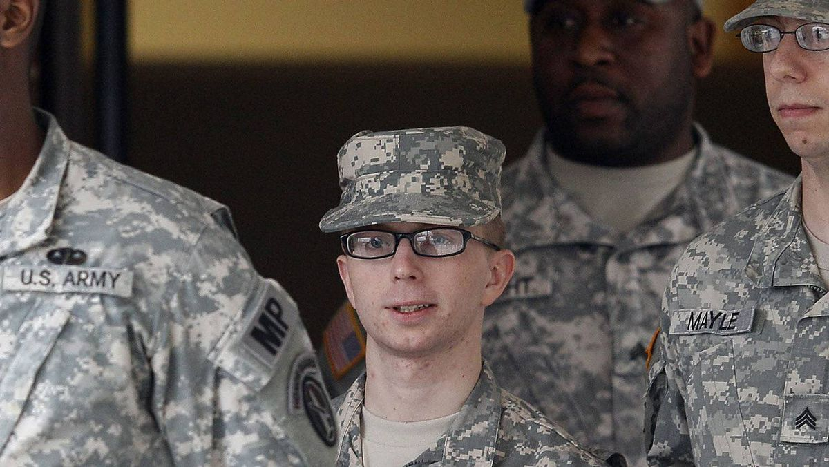 Pfc. Bradley Manning is escorted from a courthouse in Fort Meade, Md., Wednesday, Dec. 21, 2011.